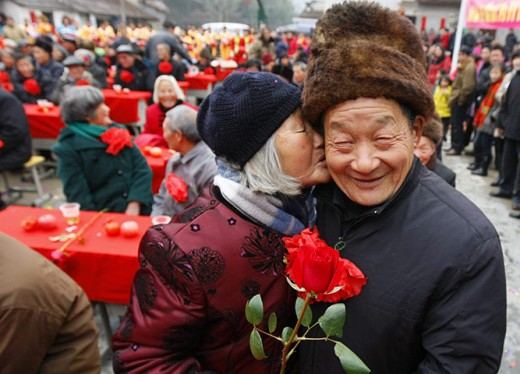 Chinese celebration - gathering of married couples married over 50 years.  Photograph: Guo Bin/EPA