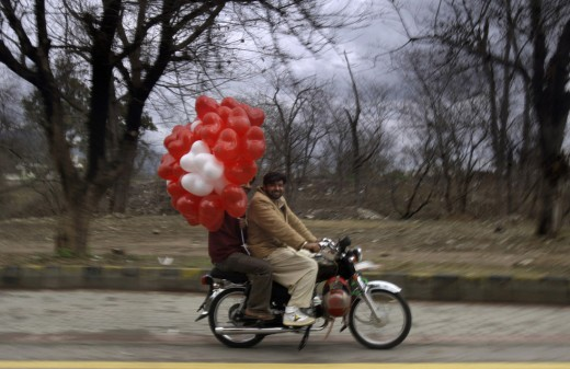 Balloon vendor in Pakistan sells his products on Valentine's Day. AP / Muhammed Muheisen