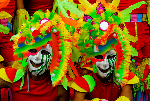 """Dare to frown: Revelers pose """"happily"""" during the MassKara Festival in Bacolod."""