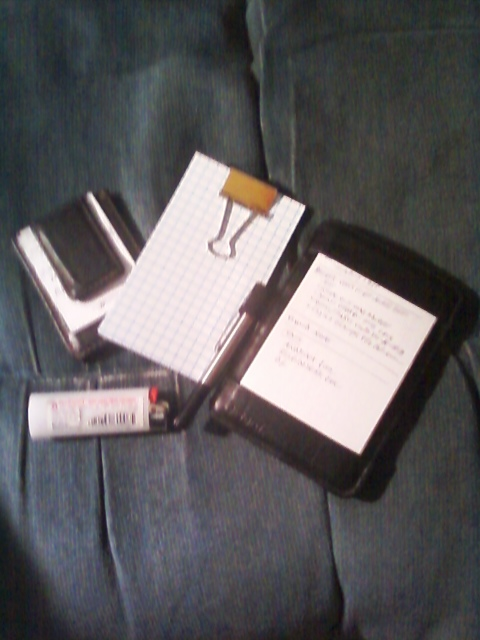 The classic Hipster PDA (center) is flanked by a miniature version made from half-sized index cards and magnetic money clip, and the author's unit.