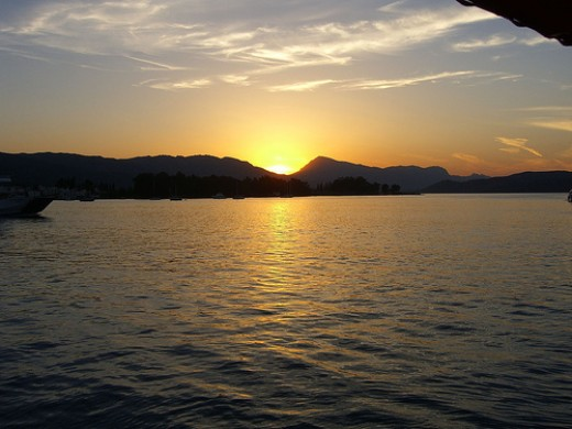 Sunset on the water. Greece. Photo by Adventurous Wench