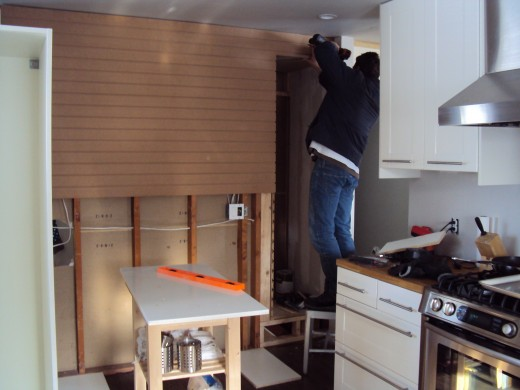 Slatwall being installed in kitchen