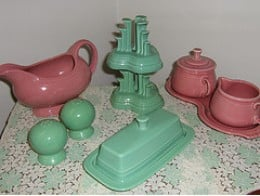 Butter dish,  salt & pepper shakers, Figure Eight Sugar Bowl and Creamer, Gravy Boat, Candle Holders in Rose and Seamist. Everyone compares the gravy boats to Aladdin's Lamps!