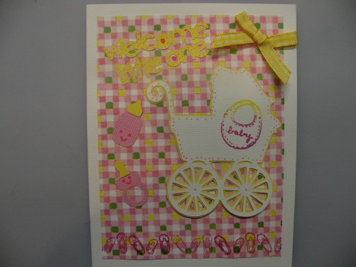 The sweet bow adds just the right touch.  Also stamps of baby items can be added as shown.