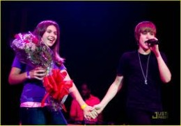 At each concert Justin Bieber brings one girl fan on stage to give her a dozen roses while he serenades her with his voice and touch.  Most of the time you will see the girls either crying or hold their mouths.  Pure happiness!
