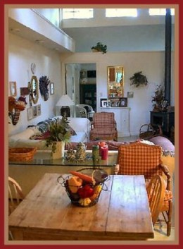 The same room, re-arranged, pictures grouped, accessories carefully placed.