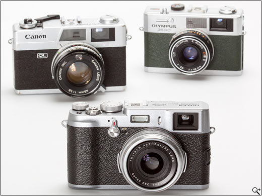 FinePix X100 in foreground. 1970s Canon rangefinder on back left; 1970s Olympus rangefinger on back right