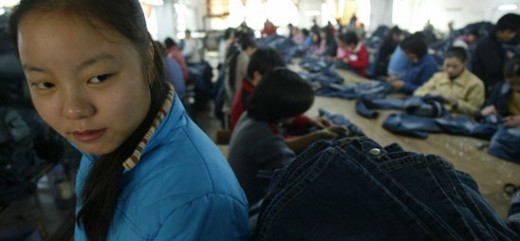 17-year old Jasmine works in pitiful conditions, blue jeans factory such as this are prevalent in China.