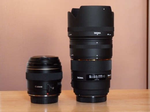 Two 85mm lenses.. the Canon 85mm f/1.8 on the left and the Sigma 85mm f/1.4 on the right.