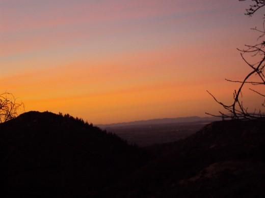 Orange streaks in the sunset sky.