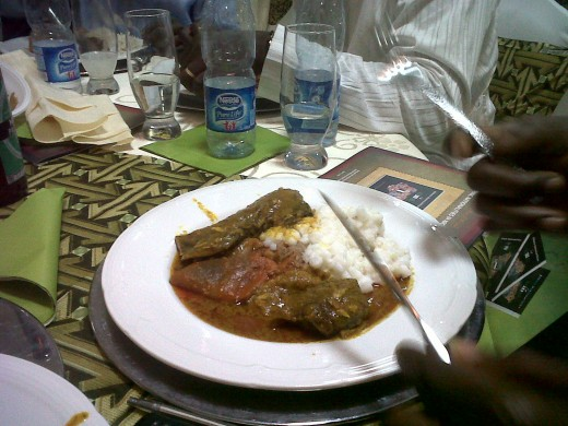this is our Nigerian rice called Ofada Rice with goat meat and stew