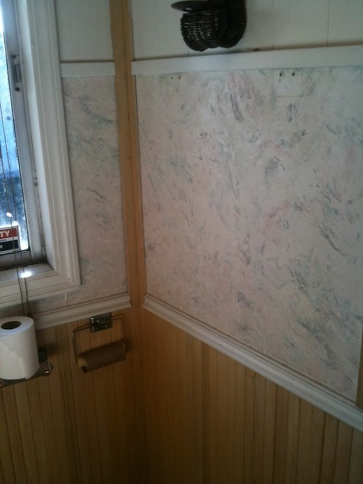 The ugly wallpaper on the other walls in the bathroom ... What the hell was the previous owner thinking?!