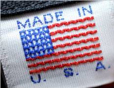 embroidered clothing label in red white and blue with the American flag and the words Made in the U.S.A.