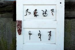 """""""Couplet"""", Feng Jin. 2011. Bronze & Door. 32 x 82 x 5"""" (partial)"""