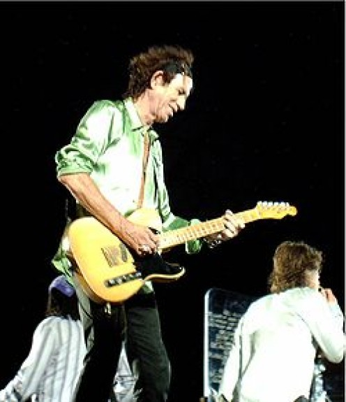 Richards with butterscotch Telecaster used for open G, five-string tuning