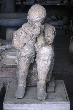 Plaster Cast Of Crouched Victim, Pompeii. Photo by TyB (flickr)