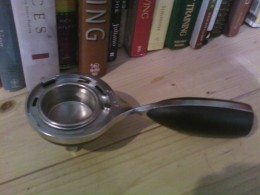 Tamp the ground coffee down with the recepticle insdie the TWIST machine.