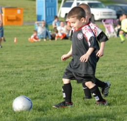 little kids playing AYSO soccer