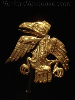 Golden Raven Brooch by Bill Reid master carver and jeweler, Haida.