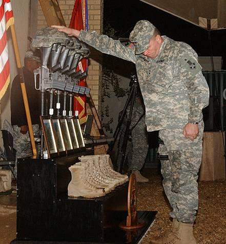 This must be a gut wrenching experience for the soldiers who are left behind. Still, the pain this man must be feeling is nothing compared with the weight of the sacrifice the soldiers who wore these boots and helmets gave for us all.