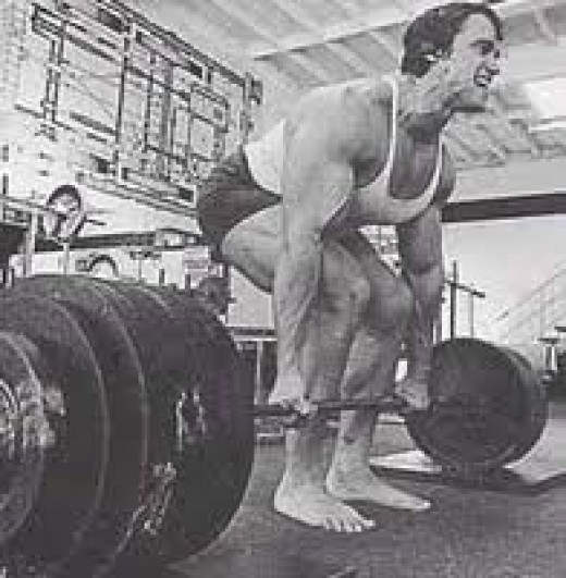 Arnold deadlifting. Nothing simpler than lifting heavy stuff off the ground.