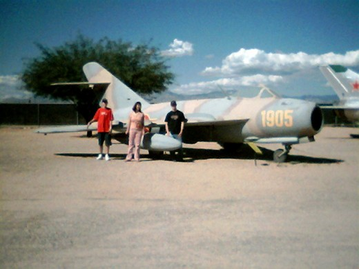 My wife and two of my sons by a MiG-U15T1