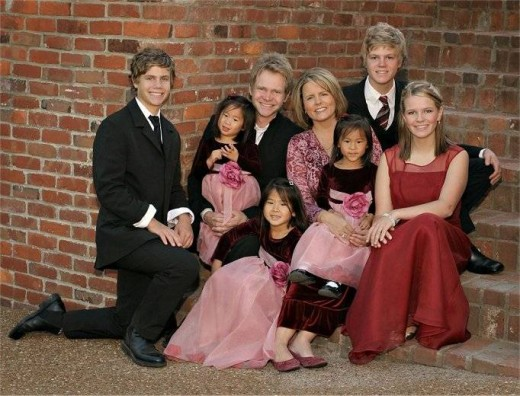 Steven and Mary Beth Chapman with their three biological children and their three adopted children from China.