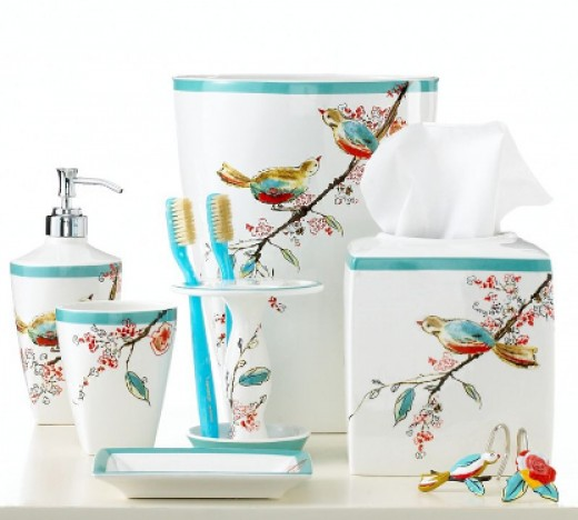 beautiful bathroom set in porcelain with birds branches and a coordinate color of aqua