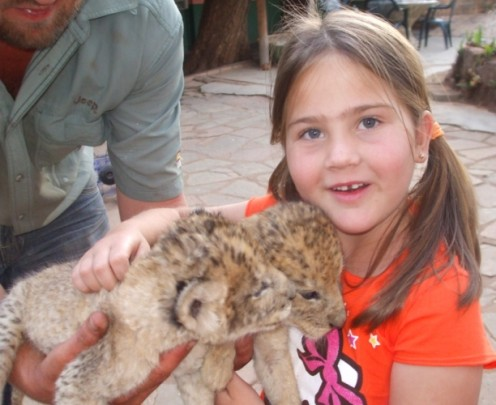 Danay holding TWO lion cubs