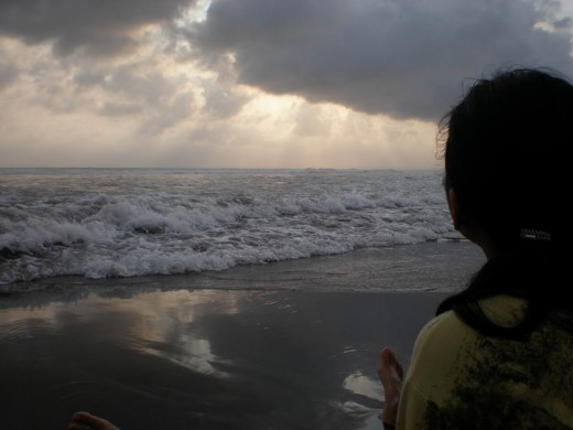 My daughter's waiting for sunset at Pangandaran West Beach.