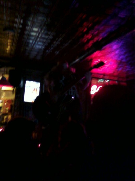 It's difficult to see but this is a pic of lead singer Sarah Blackwood standing on the bar playing her guitar