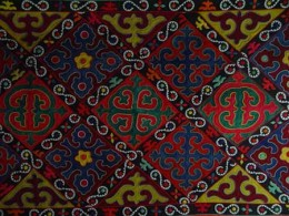 Felt rug with traditinal applique designs of waves and mountains. These are used to decorate homes and yurts.