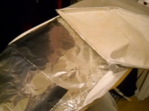 Aluminium foil under iron board cover.