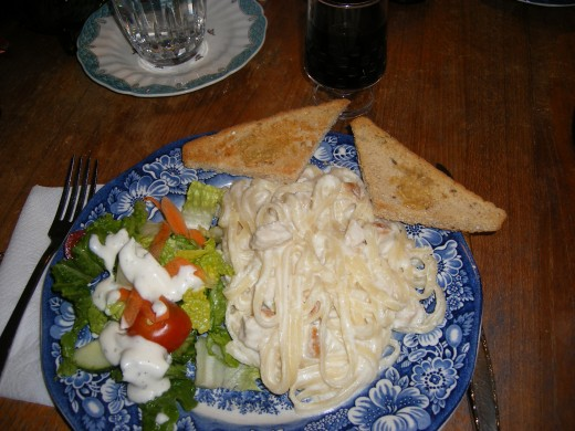 The end result -- Chicken Fettuccini Alfredo, salad, garlic bread and a glass of wine.