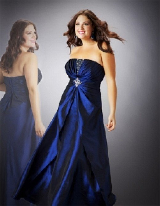 Cassandra Stone II Plus size prom dress in navy, priced at $318 at cinderellagowns.com Photo credit: cinderellagowns.com