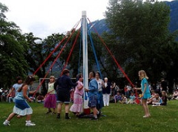 May Day or Beltane Dancing around a Maypole, a Pagan Nature Celebration still celebrated in Ireland and Scotland