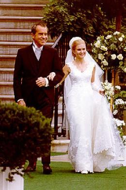 Tricia Nixon and President Nixon in the rose garden.
