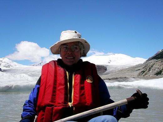 Paddling on the fridgid Glaciel lake formed by the melting glacier