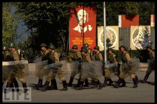"""The irony: the billboard with the image of Lenin reads """"We want the Brotherly Union of All Nations"""".  Soldiers are about to make sure that everybody complies... I assume."""
