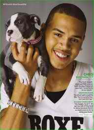 I love this photo of Chris with this adorable Little Pup.