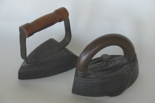Early 'Sad' irons. (Rt)Pott's style with removable handle.