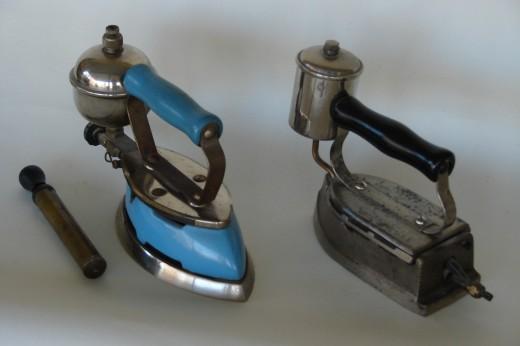 (L) Colman 'White Gas' or Kerosene Iron with pump. (R) Early Alcohol or Spirit iron.