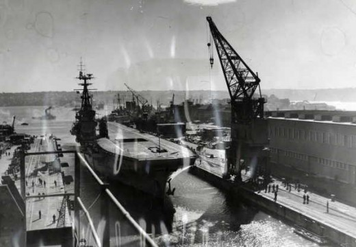 I suspect this is Sydney in her earlier days.   Looks like a cruiser in background.   HMAS Australia, maybe, or perhaps Shropshire.