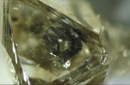 Diamond formed around an iron sulfide crystal.