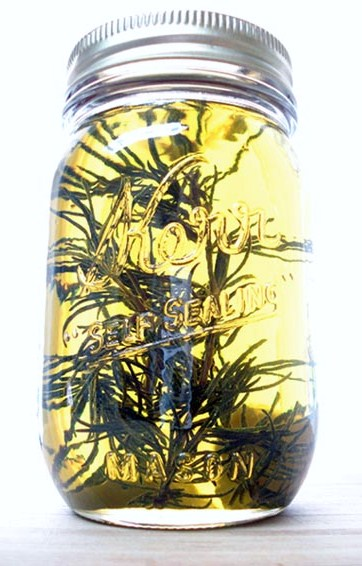 Whether it's bottled in old canning jars or bird-topped charmers like those featured below, herb-infused oil makes a thoughtful (and delicious) gift on Mother's Day.