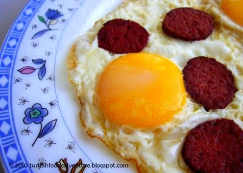 Sucuklu Yumurta - Turkish Style Fried Eggs Topped with Dry Spicy Beef Sausage.