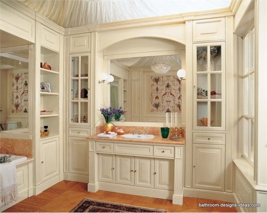 white bathroom cabinets with extensive use of glass front cabinets
