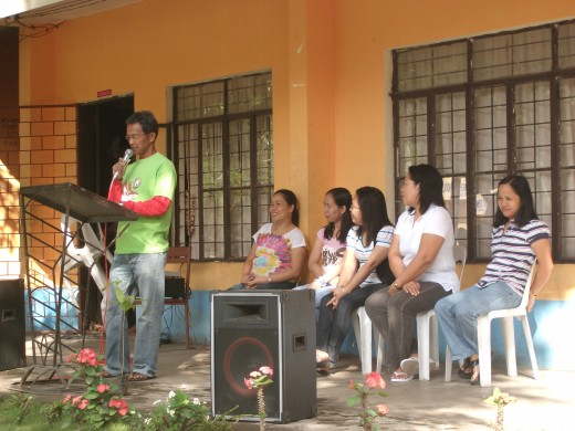 ACT IN UNISON. Teachers headed by CAT Facilitator Juanito C. Bayos orient students on the tree planting activity.