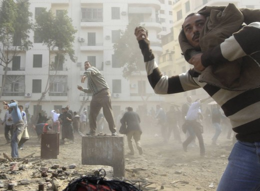 Opposition supporters throw stones at pro-Mubarak demonstrators in Tahrir Square in Cairo February 3, 2011
