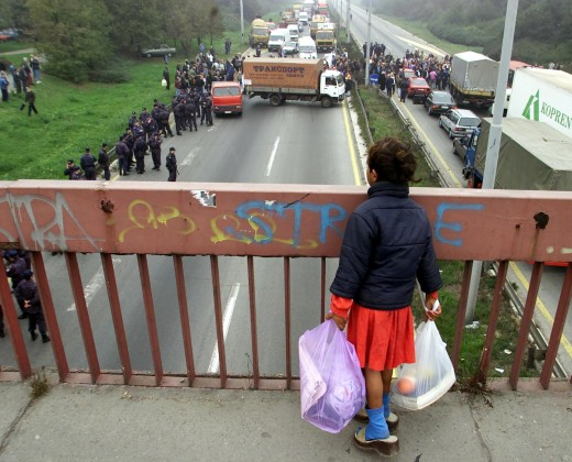 A girl looks on a blockade set up by protesters of the Serbian Trade Union Confederation within the scope of a strike over a proposed labour law, that the workers say does not take care of their rights, in Belgrade October 19, 2001.
